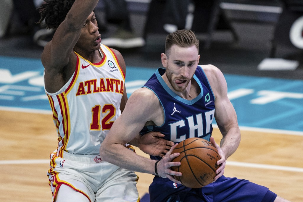 Charlotte Hornets forward Gordon Hayward is guarded by Atlanta Hawks forward De'Andre Hunter (12) during the second half of an NBA basketball game in ...