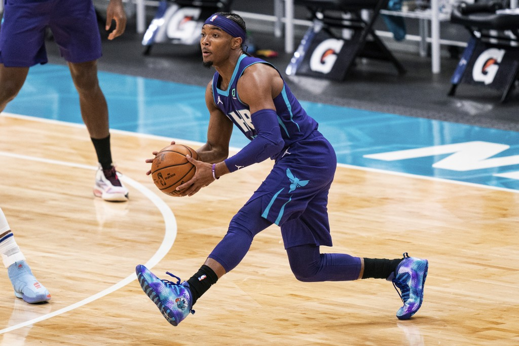 Charlotte Hornets guard Devonte' Graham passes the ball during the first half of the team's NBA basketball game against the Atlanta Hawks in Charlotte...