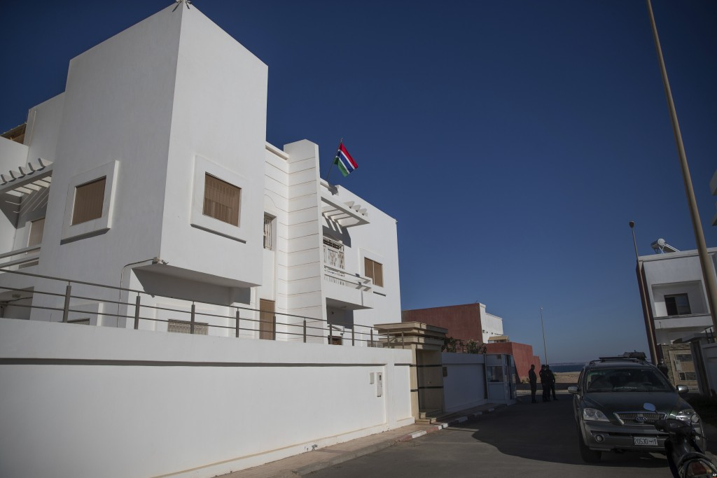 Security forces stand guard outside a recently opened consulate of The Gambia in Dakhla city, Western Sahara, Monday, Dec. 21, 2020. U.S. plans to ope...