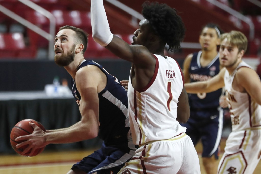 Virginia's Jay Huff, left, looks to shoot against Boston College's CJ Felder (1) during the first half of an NCAA college basketball game, Saturday, J...