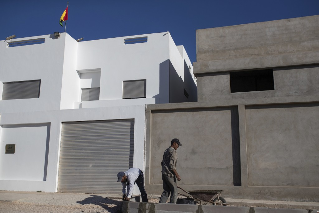 Construction men at work in a neighborhood containing recently opened consulates in Dakhla, Western Sahara, Monday, Dec. 21, 2020. .S. plans to open a...