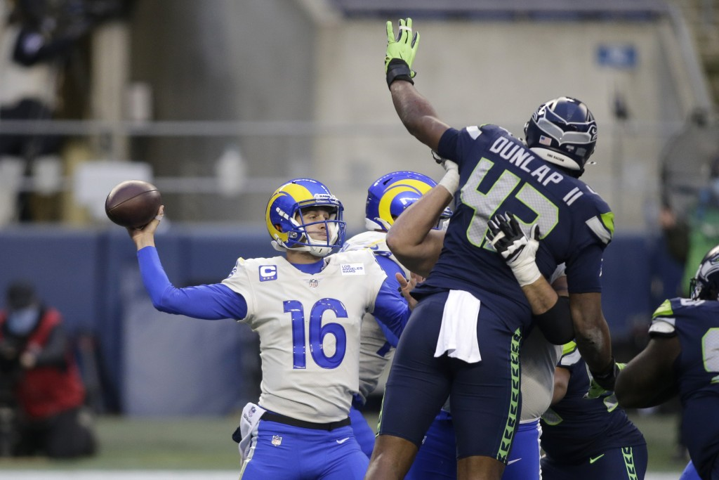Seattle Seahawks defensive end Carlos Dunlap (43) leaps to try and deflect a pass from Los Angeles Rams quarterback Jared Goff during the second half ...