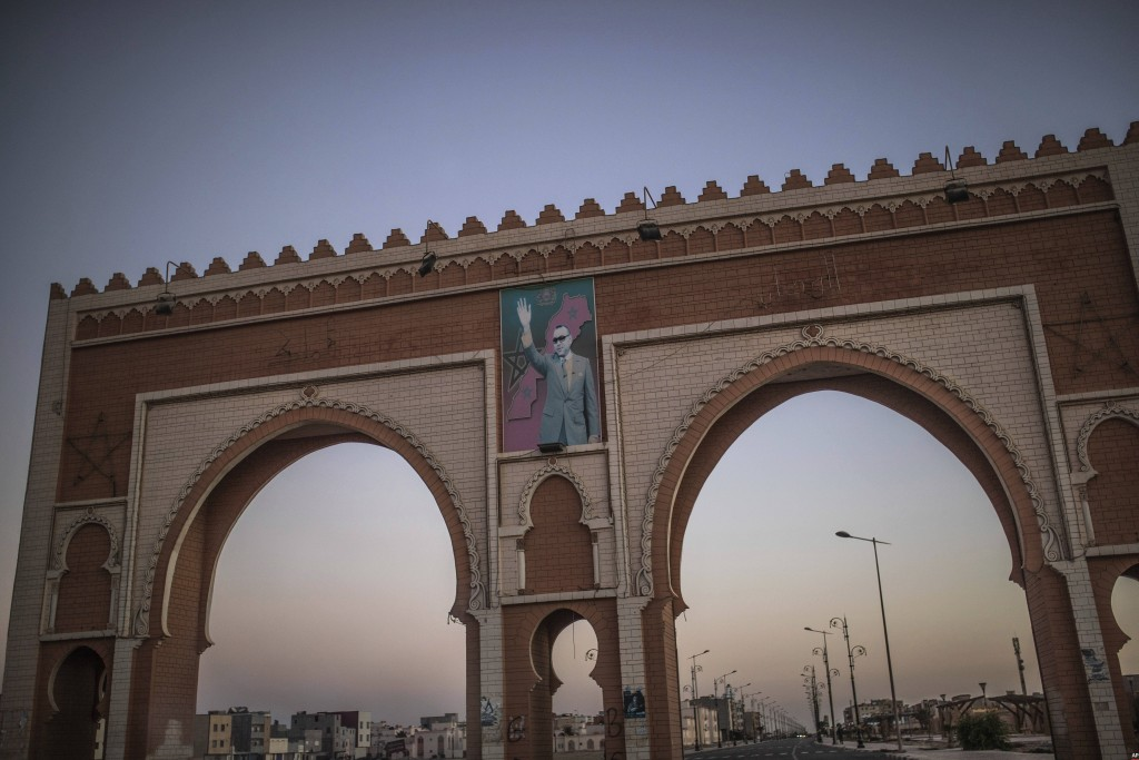 An archway in the entrance of Dakhla carries an image of Morocco's King Mohammed VI, in Western Sahara, Monday, Dec. 21, 2020. U.S. plans to open a co...