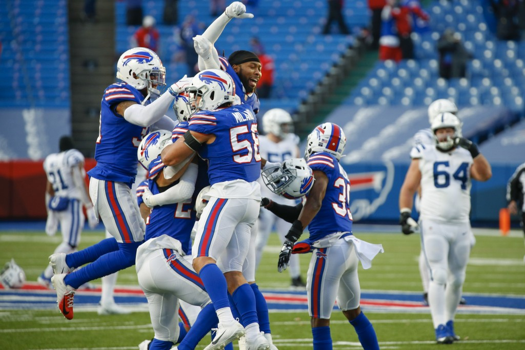 Buffalo Bills' Matt Milano (58) celebrates with teammates after an NFL wild-card playoff football game against the Indianapolis Colts Saturday, Jan. 9...