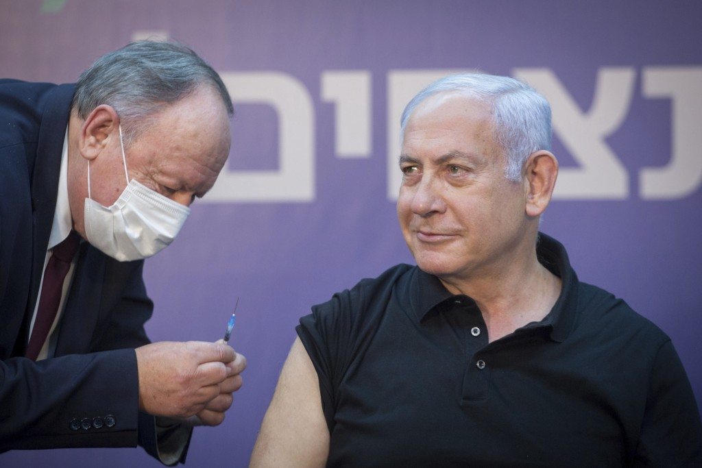 Israeli Prime Minister Minister Benjamin Netanyahu is ready to receive the second COVID-19 vaccine at Sheba Medical Center in Ramat Gan, Israel, on Sa...