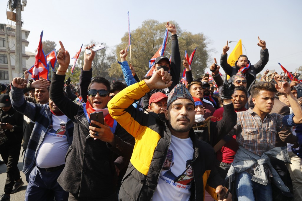 Nepalese pro-king supporters march demanding reinstating monarchy that was abolished more than a decade ago in Kathmandu, Nepal, Monday, Jan.11, 2021....