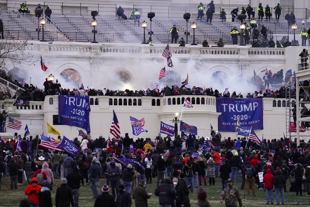 FILE - In this Wednesday, Jan. 6, 2021, file photo, violent protesters, loyal to President Donald Trump, storm the Capitol, in Washington. Federal pro...
