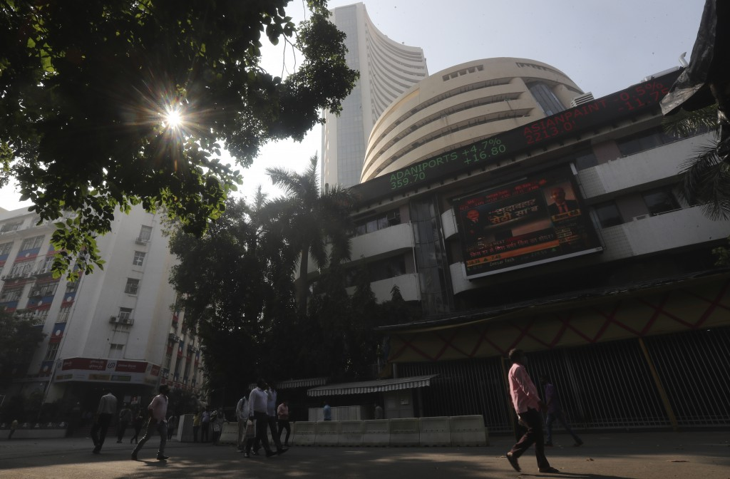 People walk past the Bombay Stock Exchange (BSE) building in Mumbai, India, Monday, Jan. 11, 2021. Global shares and U.S. futures were mostly lower Mo...