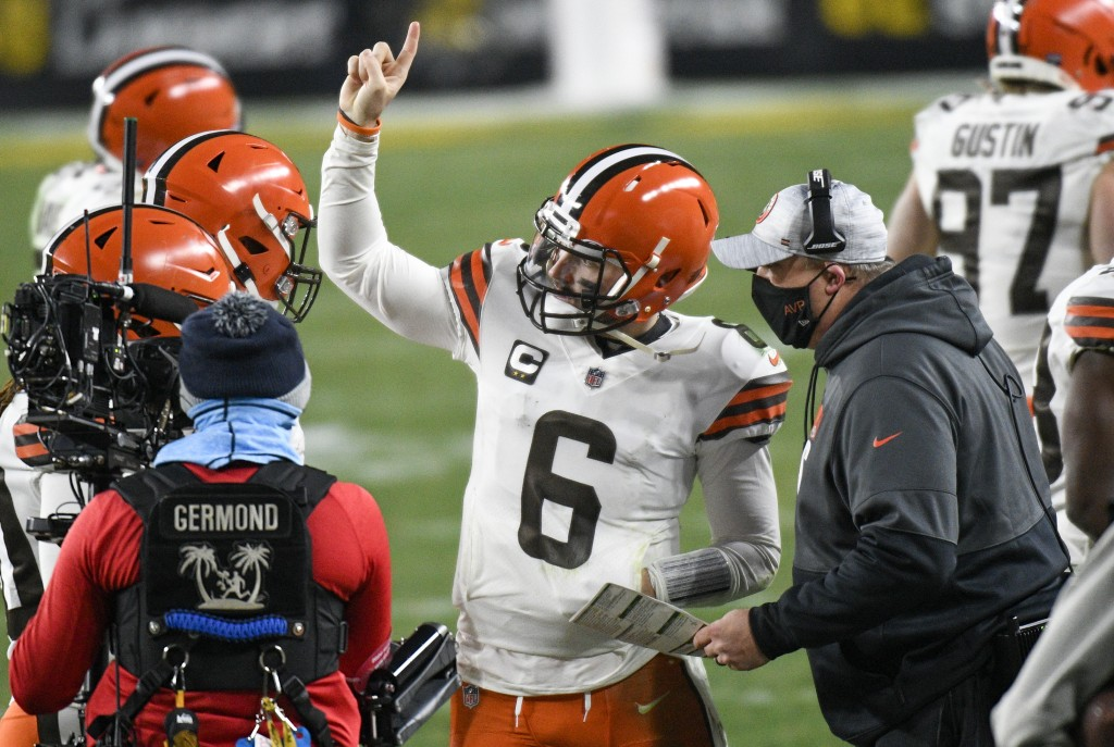 Cleveland Browns offensive coordinator Alex Van Pelt, right, talks with quarterback Baker Mayfield (6) on the sideline during the second half of an NF...