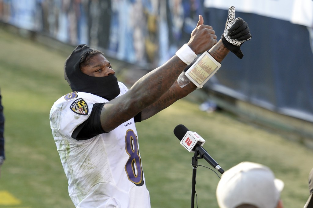 Baltimore Ravens quarterback Lamar Jackson celebrates after the Ravens beat the Tennessee Titans in an NFL wild-card playoff football game Sunday, Jan...
