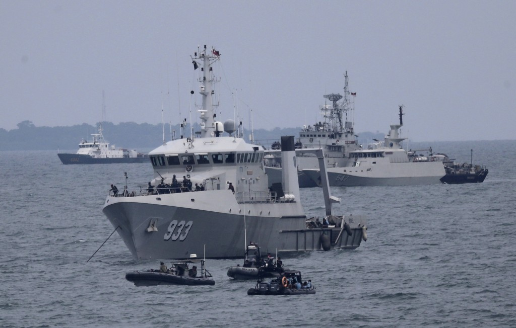 Indonesian Navy ships continue their search for the wreckage of Sriwijaya Air passenger jet that crashed into Java Sea near Jakarta, Indonesia, Monday...