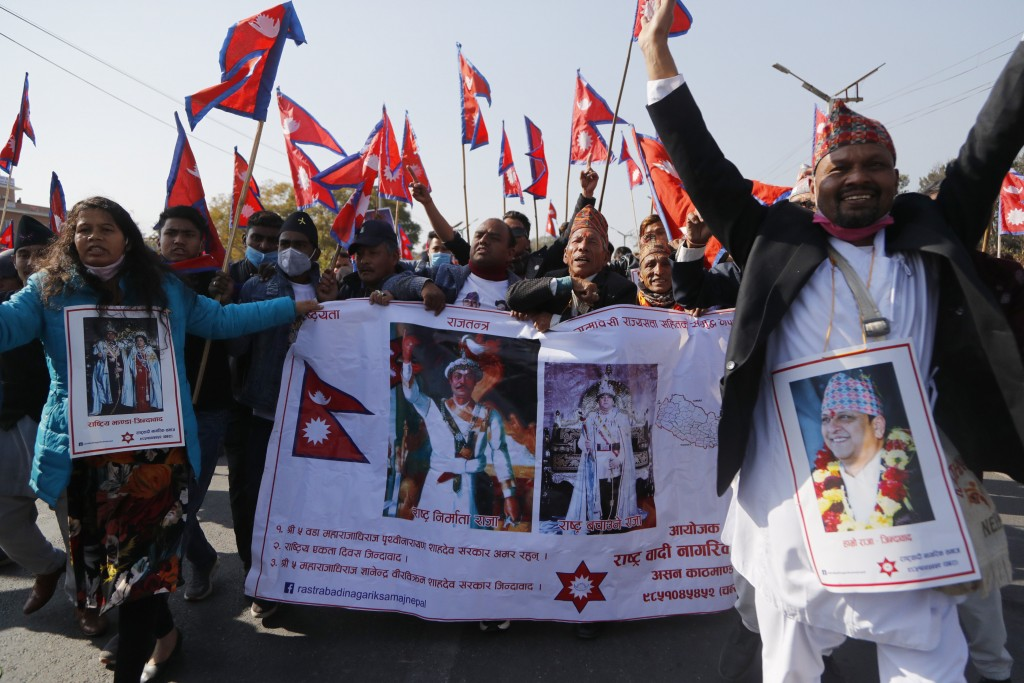 Pro-king supporters march demanding reinstating monarchy that was abolished more than a decade ago in Kathmandu, Nepal, Monday, Jan.11, 2021. Monday's...