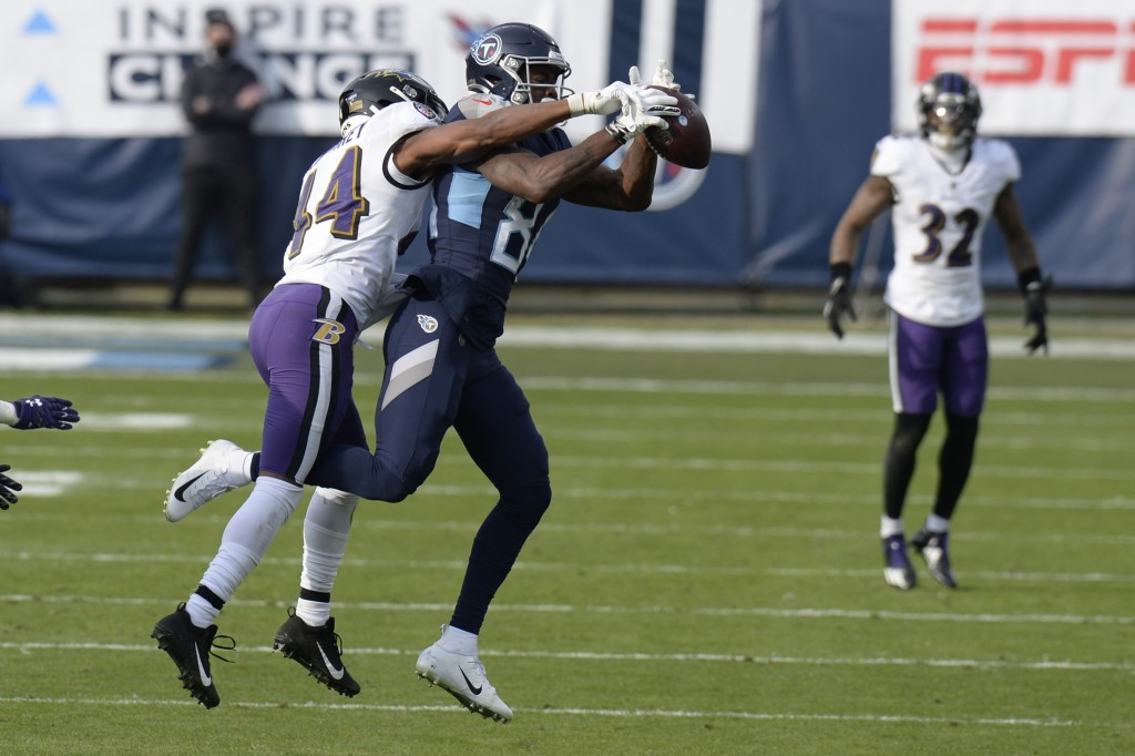 Baltimore Ravens cornerback Marlon Humphrey (44) breaks up a pass intended for Tennessee Titans wide receiver Corey Davis (84) in the second half of a...