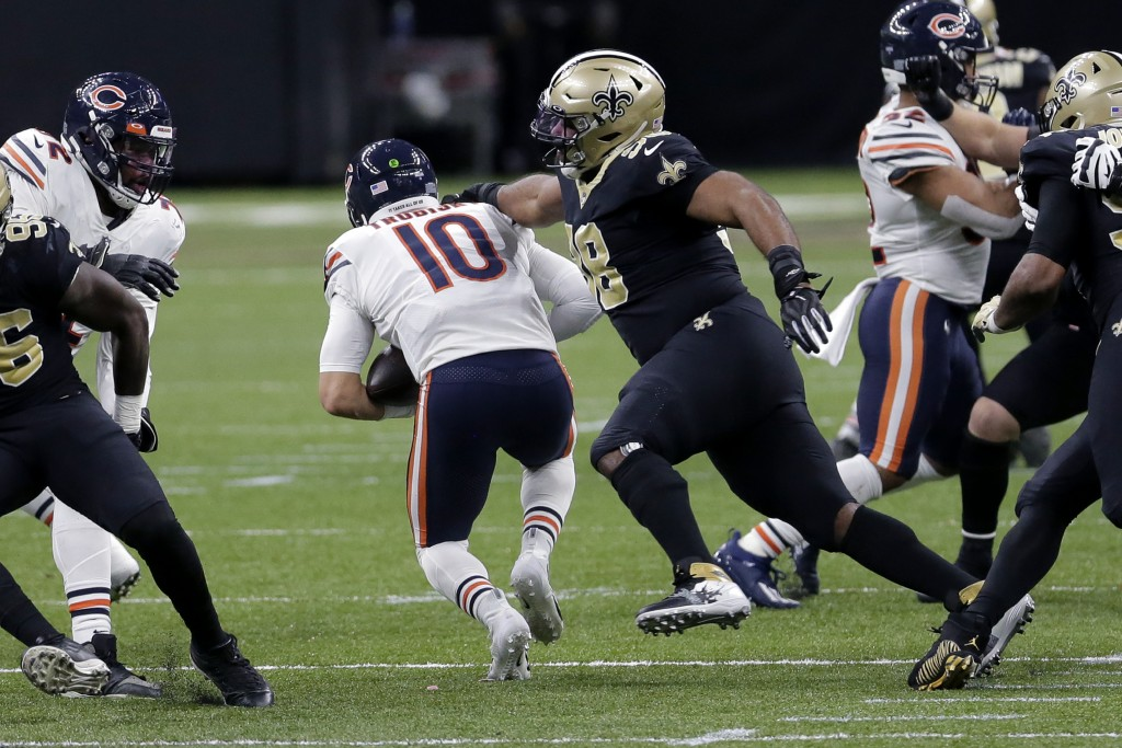 Chicago Bears quarterback Mitchell Trubisky (10) is sacked by New Orleans Saints defensive tackle Sheldon Rankins (98) in the second half of an NFL wi...
