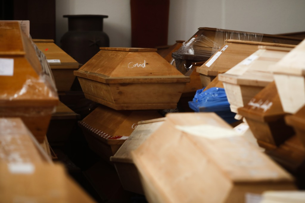 Coffins containing deceased people wait in the worship room of the crematorium in Meissen, Germany, before cremation on Monday, Jan. 11, 2021. For tho...