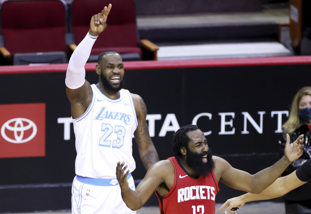 James Harden, right, of the Houston Rockets, reacts to a call ahead of LeBron James, left, of the Los Angeles Lakers during the first quarter of an NB...