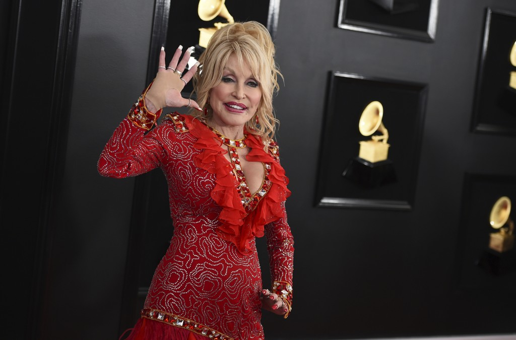 FILE - Dolly Parton arrives at the 61st annual Grammy Awards on Feb. 10, 2019, in Los Angeles. Parton turns 75 on Jan. 19. (Photo by Jordan Strauss/In...