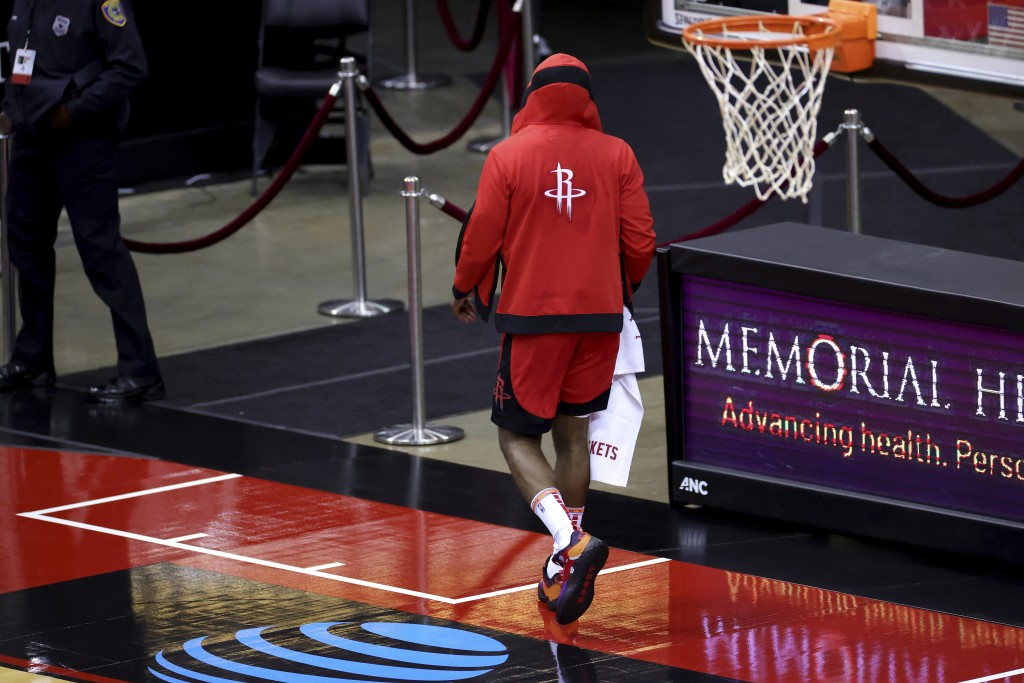 Houston Rockets' James Harden leaves the court following a loss to the Los Angeles Lakers in an NBA basketball game Sunday, Jan. 10, 2021, in Houston....