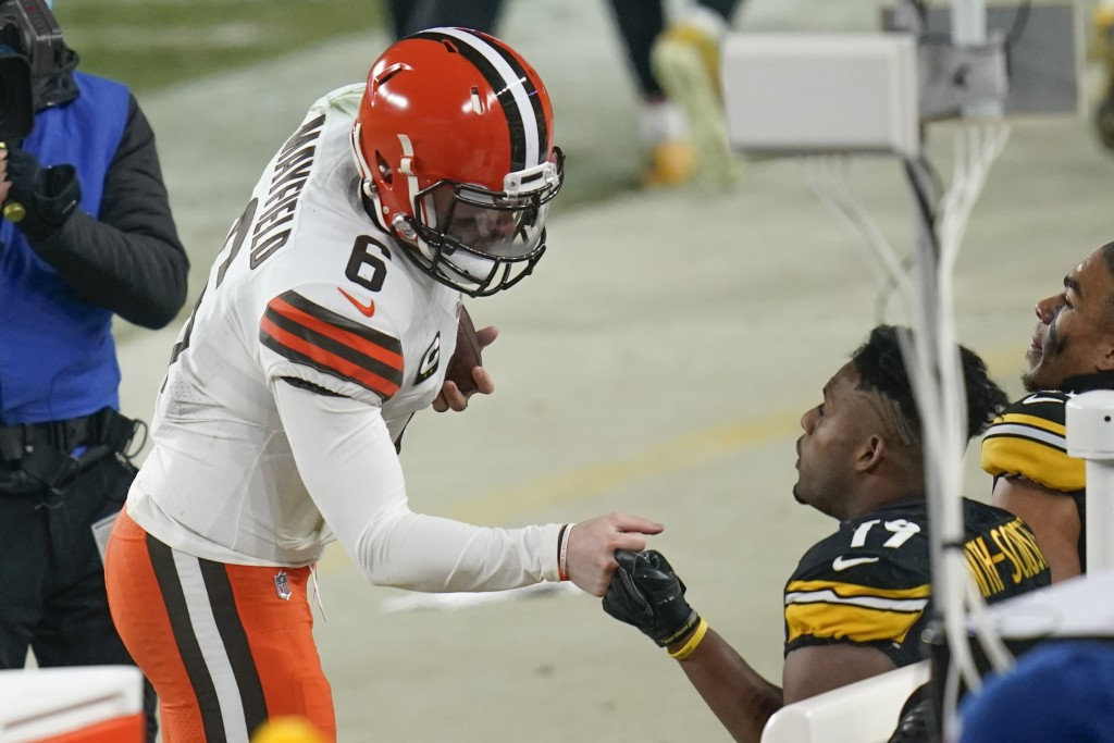 Cleveland Browns quarterback Baker Mayfield (6) greets Pittsburgh Steelers wide receiver JuJu Smith-Schuster (19) after defeating them in an NFL wild-...