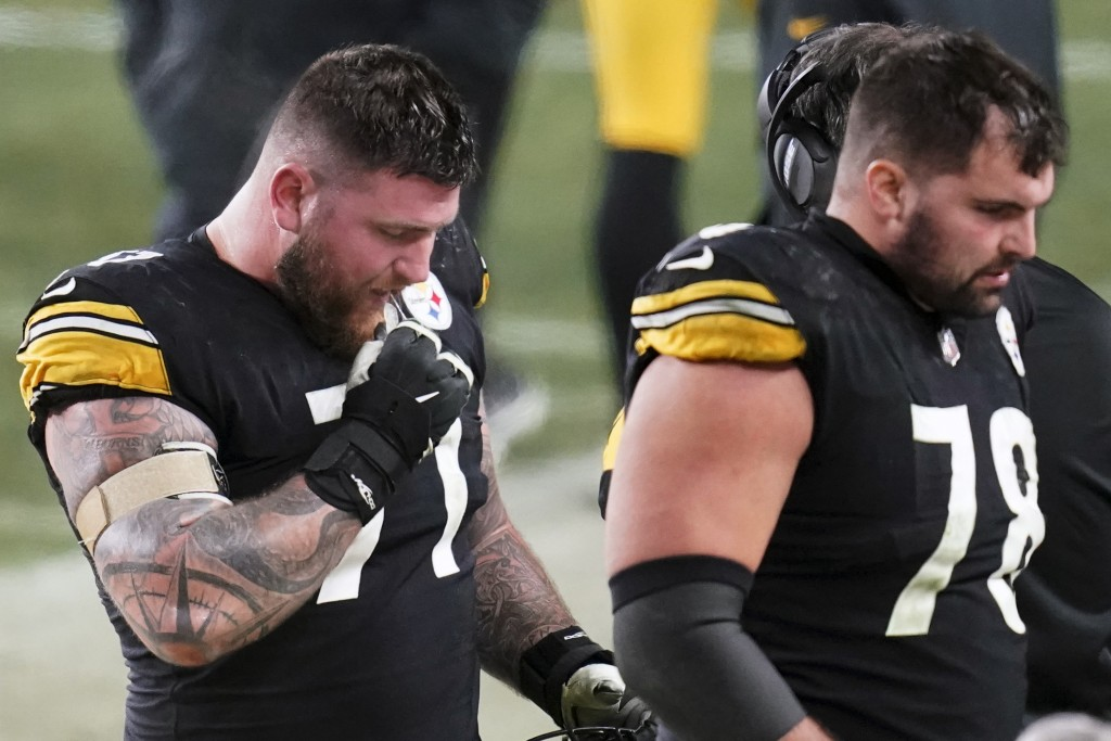 Pittsburgh Steelers offensive guard Matt Feiler (71) and offensive tackle Alejandro Villanueva (78) walk off the field after the Cleveland Browns inte...