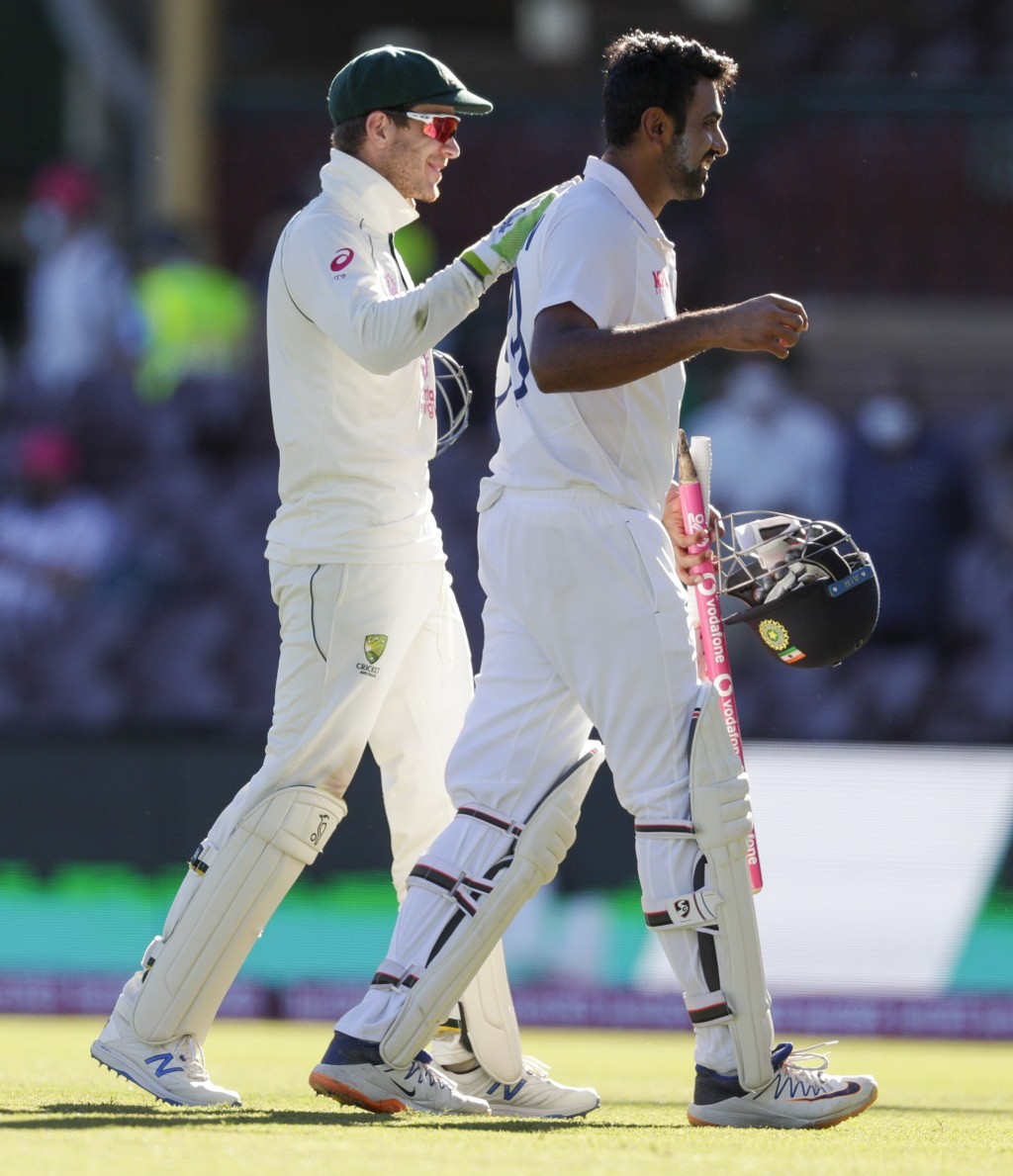 Australian captain Tim Paine, left, congratulates not out batsman India's Ravichandran Ashwin following play on the final day of the third cricket tes...