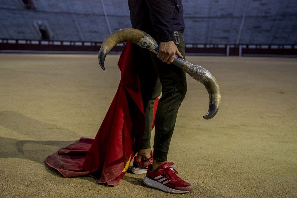 A pupil holds a set of plastic bull horns at the Bullfighting School at Las Ventas bullring in Madrid, Spain, Tuesday, Dec. 22, 2020. At the age of 14...