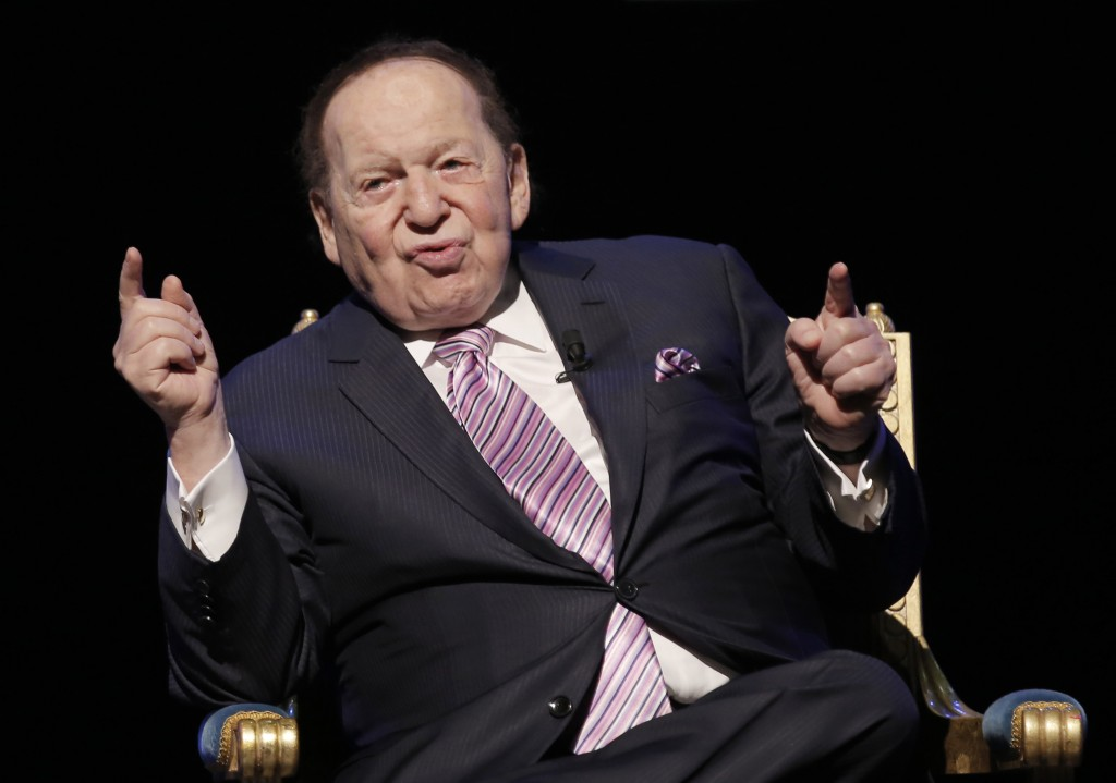 FILE - In this Sept. 13, 2016 file photo, U.S. billionaire Sheldon Adelson speaks during a news conference for the opening of Parisian Macao in Macau....