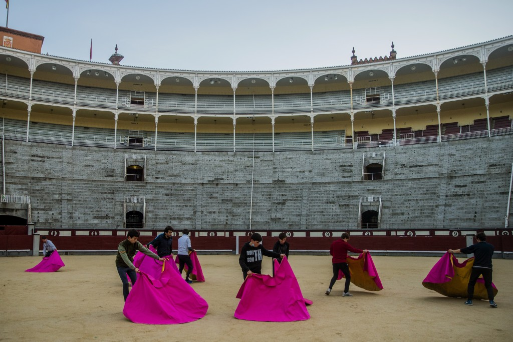 Pupils perform with their capes at the Bullfighting School at Las Ventas bullring in Madrid, Spain, Tuesday, Dec. 22, 2020. The school was closed from...