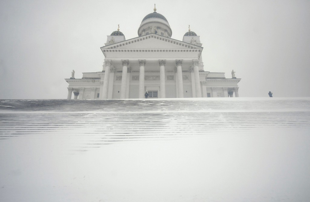 Snow sweeps across the steps before Helsinki Cathedral during a heavy snow storm making all kinds of travel difficult in Helsinki, Finland, on Tuesday...