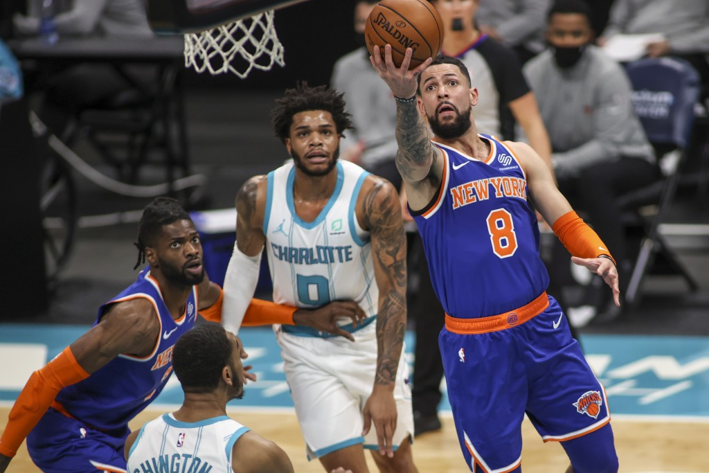 New York Knicks guard Austin Rivers (8) drives to the basket against the Charlotte Hornets in the first quarter of an NBA basketball game in Charlotte...