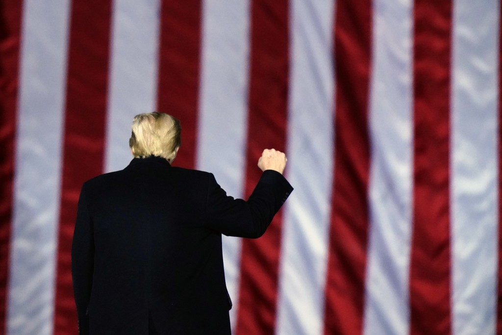FILE - In this Monday, Jan. 4, 2021, file photo, President Donald Trump gestures at a campaign rally in support of Senate candidates Sen. Kelly Loeffl...