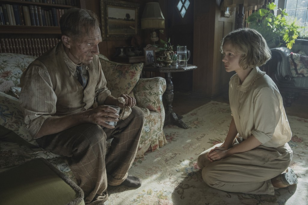 """This image released by Netflix shows Carey Mulligan, right, and Ralph Fiennes in a scene from """"The Dig.""""  (Larry Horricks/Netflix via AP)"""