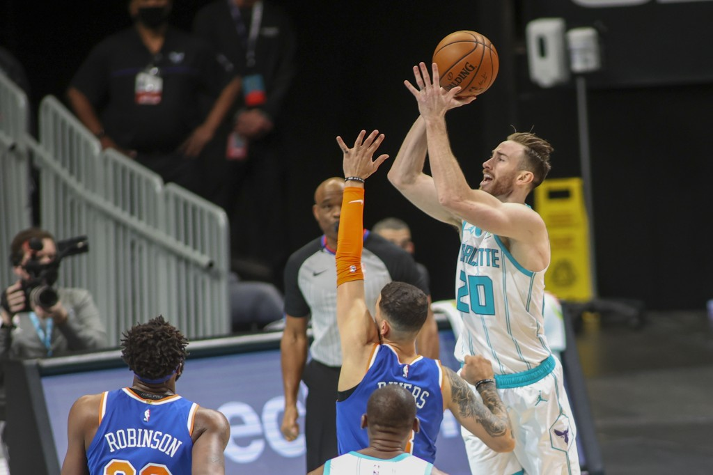 Charlotte Hornets forward Gordon Hayward (20) shoots over New York Knicks guard Austin Rivers in the first quarter of an NBA basketball game in Charlo...
