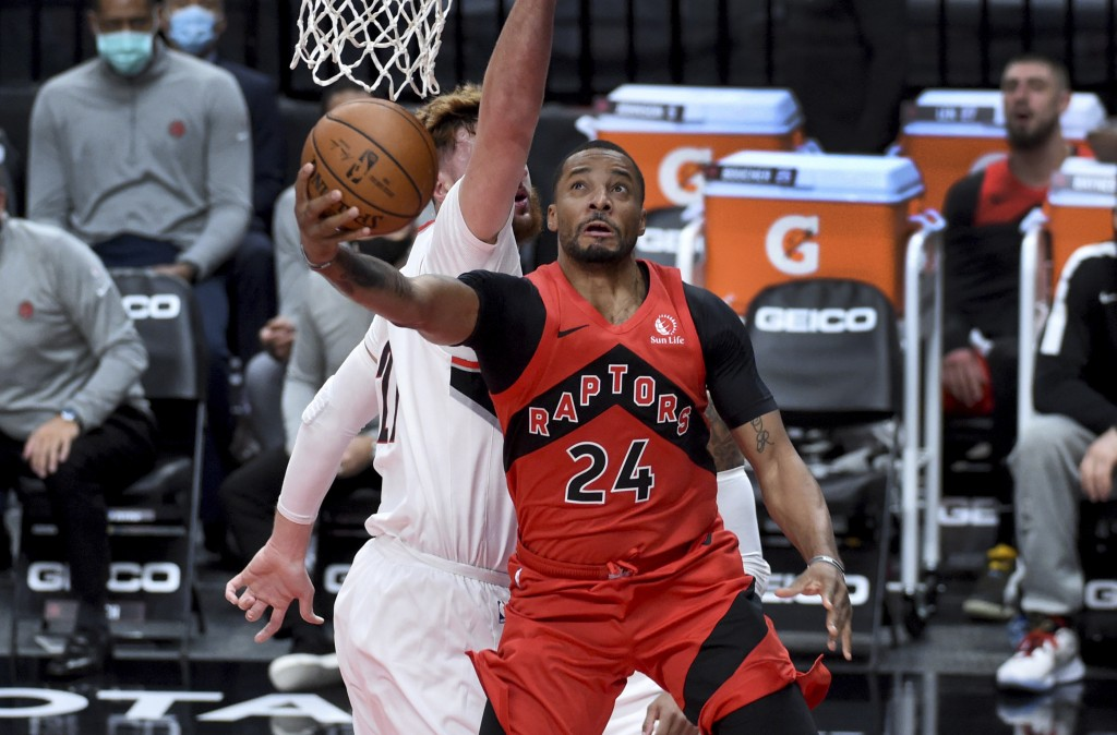 Toronto Raptors guard Norman Powell, right, drives to the basket against Portland Trail Blazers center Jusuf Nurkic, left, during the first half of an...
