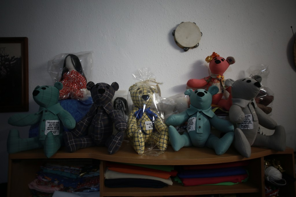 Stuffed bears ready for delivery sit in the home workshop of Erendira Guerrero, who has been making the bears for people who lost a family member to C...