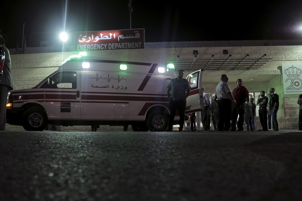 FILE - In this Nov. 6, 2019 file photo, an ambulance is parked in front of the Jerash Government Hospital, where people stabbed in a knife attack were...