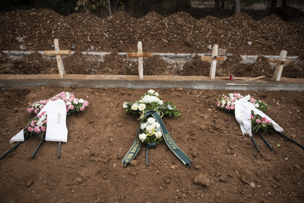 Wreaths stand on graves in a cemetery for victims of COVID-19, in the northern city of Thessaloniki, Greece, Wednesday Dec. 2, 2020. In Greece's secon...