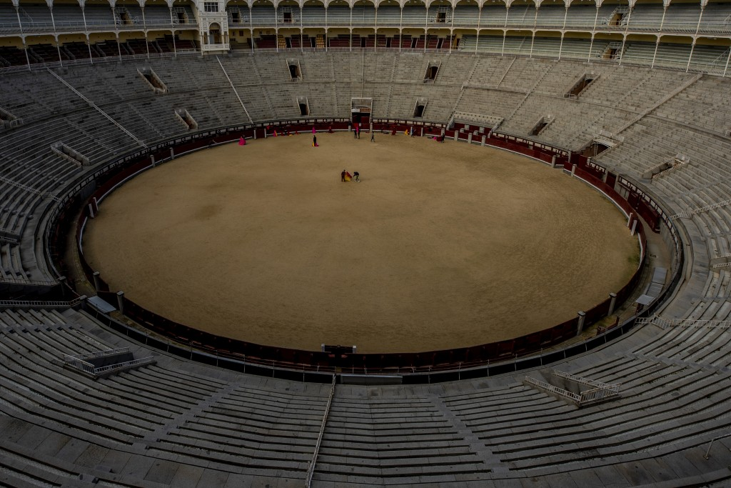 Pupils practice with their capes at the Bullfighting School at Las Ventas bullring in Madrid, Spain, Tuesday, Dec. 29, 2020. One boy practices making ...