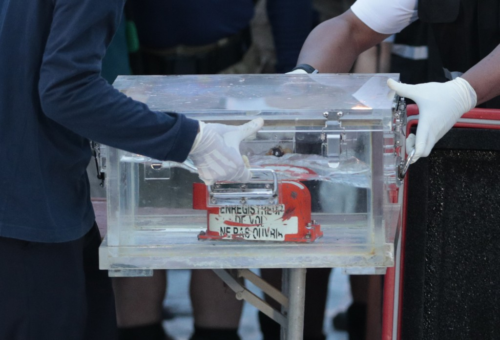 Members of National Transportation Safety Committee carry a box containing the flight data recorder of Sriwijaya Air flight SJ-182 retrieved from the ...