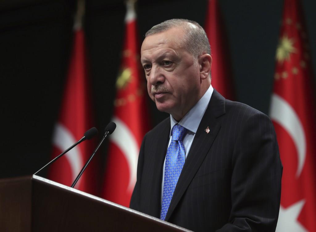 Turkey's President Recep Tayyip Erdogan speaks to reporters following a Cabinet meeting, in Ankara, Turkey, Monday, Jan. 11, 2021. Erdogan said Monday...