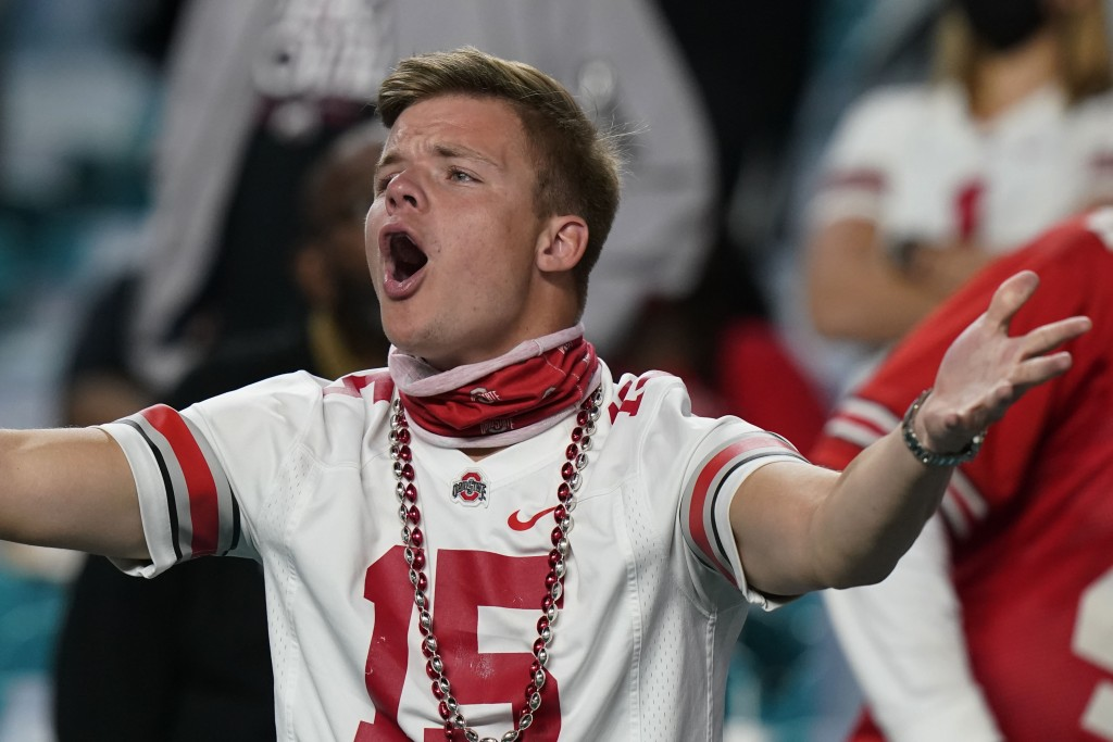 A Ohio State fan reacts during the second half of an NCAA College Football Playoff national championship game against Alabama, Monday, Jan. 11, 2021, ...