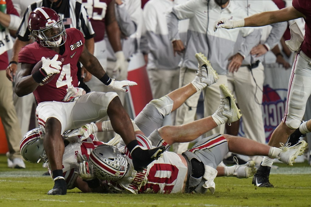 Alabama running back Brian Robinson Jr. is tackled by Ohio State during the second half of an NCAA College Football Playoff national championship game...