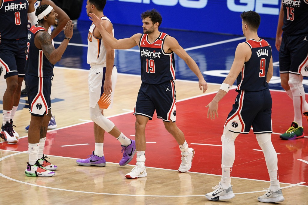 Washington Wizards guard Raul Neto (19) reacts with guard Bradley Beal, left, and forward Deni Avdija (9) during the first half of an NBA basketball g...