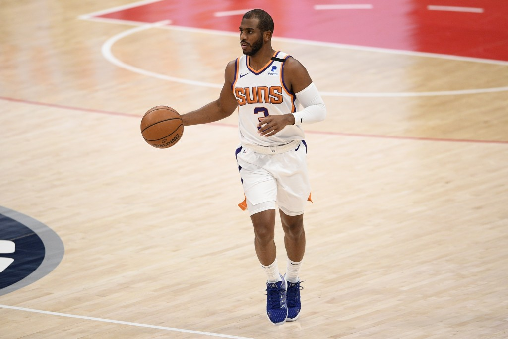 Phoenix Suns guard Chris Paul (3) dribbles during the first half of an NBA basketball game against the Washington Wizards, Monday, Jan. 11, 2021, in W...