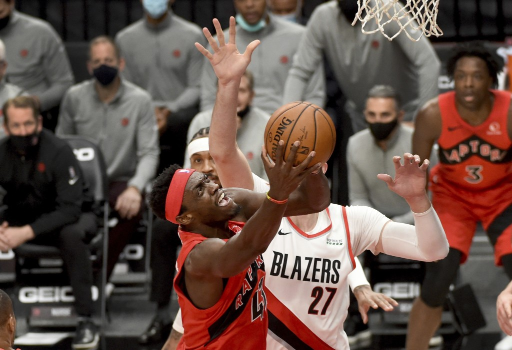 Toronto Raptors forward Pascal Siakam, left, drives to the basket against Portland Trail Blazers center Jusuf Nurkic, right, during the first half of ...