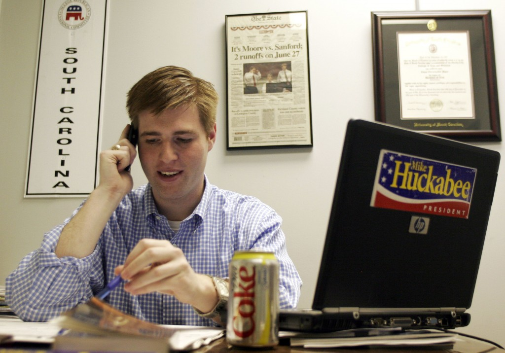 FILE - In this Dec. 28, 2007, file photo, Adam Piper, one of only four full-time staffers for Mike Huckabee's presidential campaign in South Carolina,...