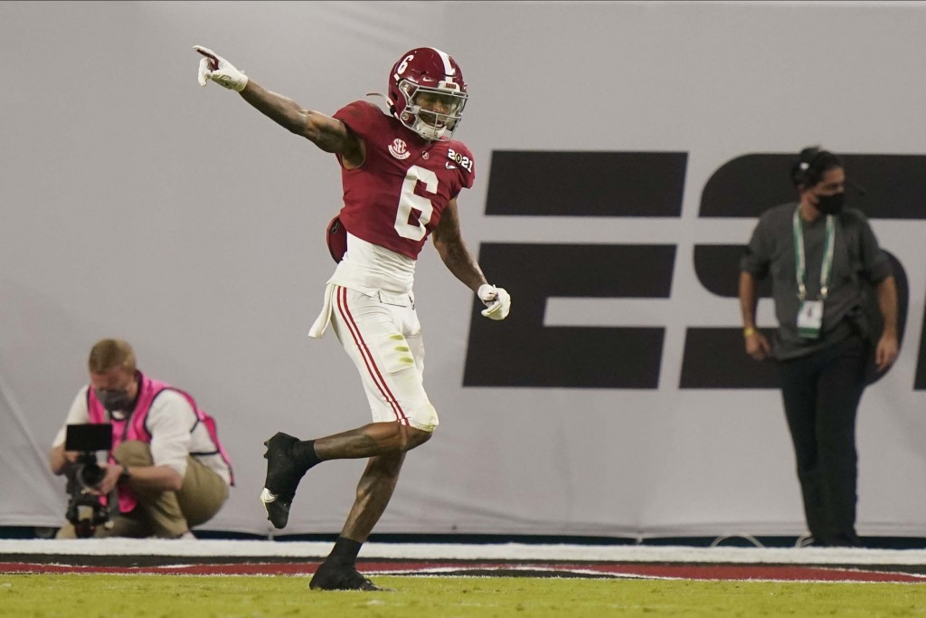 Alabama wide receiver DeVonta Smith celebrates after scoring against Ohio State during the first half of an NCAA College Football Playoff national cha...