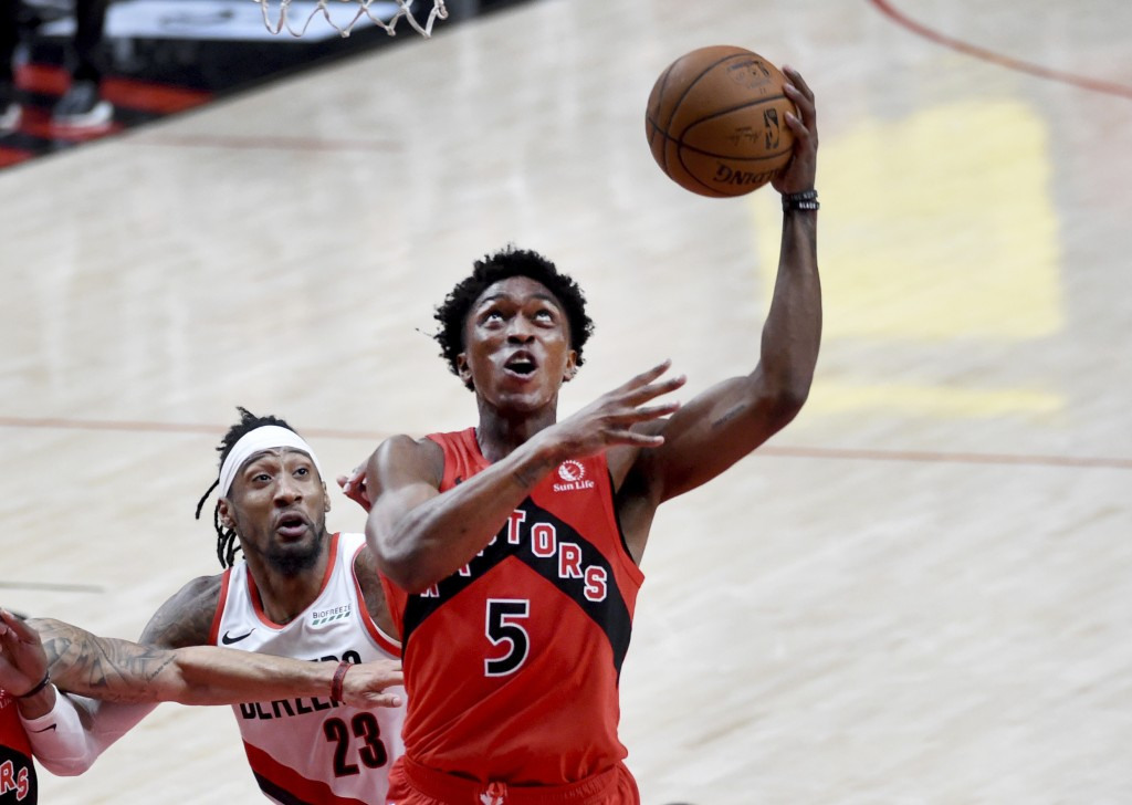 Toronto Raptors forward Stanley Johnson, right, drives to the basket past Portland Trail Blazers forward Robert Covington, left, during the second hal...