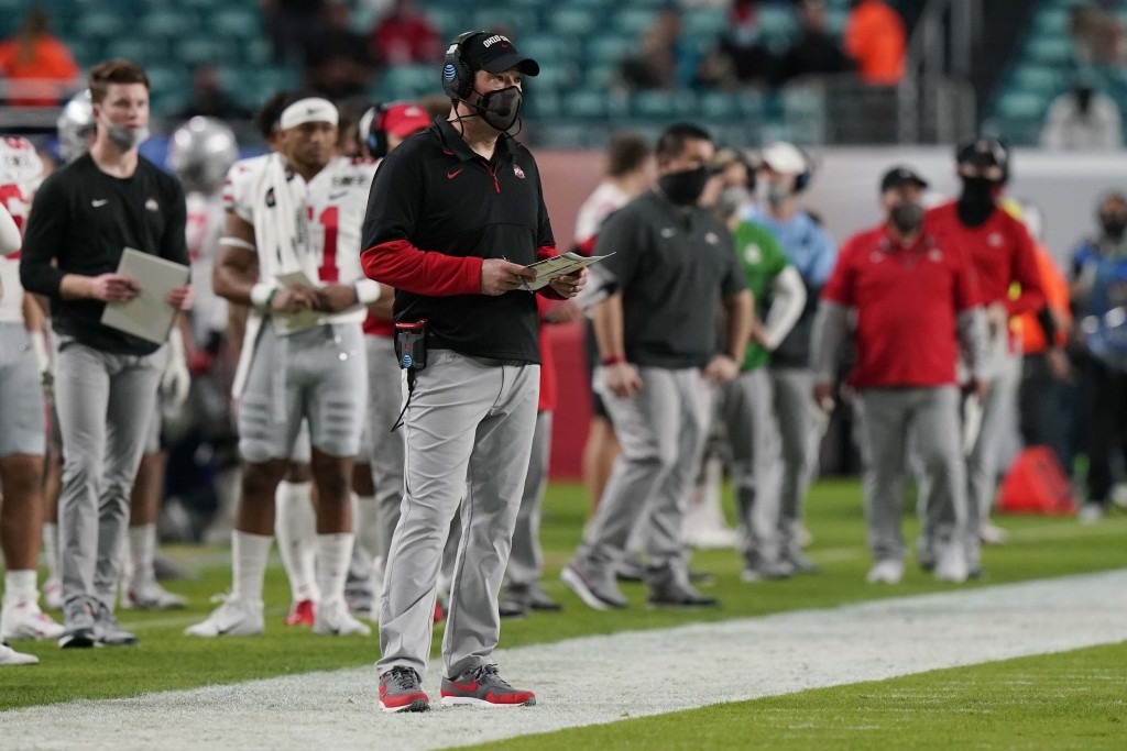 Ohio State head coach Ryan Day watches his team during the first half of an NCAA College Football Playoff national championship game against Alabama, ...