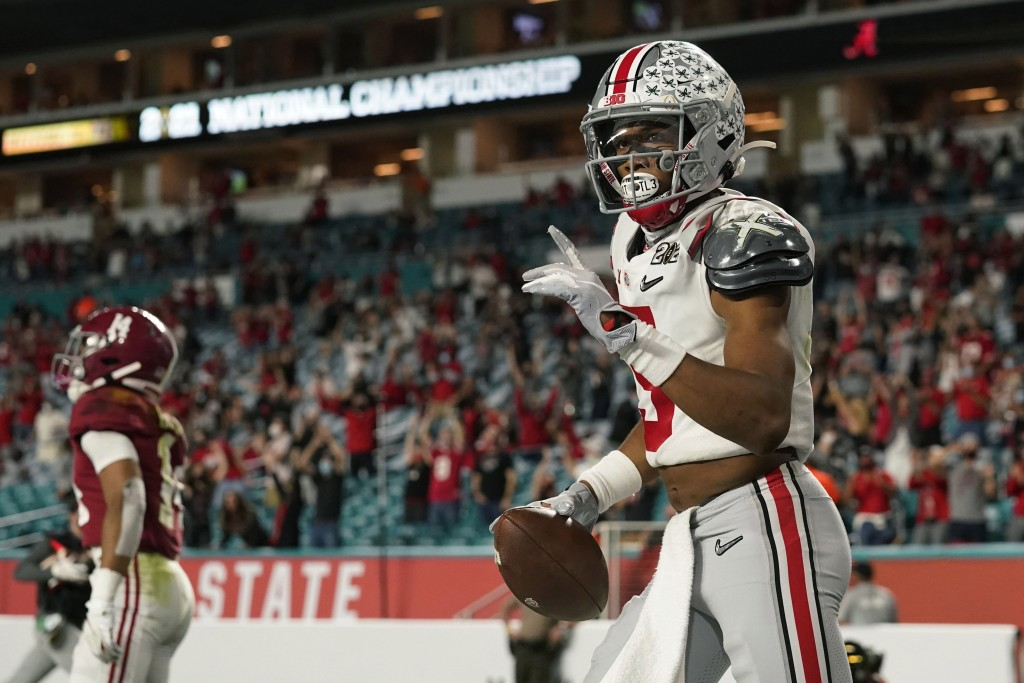 Ohio State wide receiver Garrett Wilson celebrates after scoring against Alabama during the second half of an NCAA College Football Playoff national c...